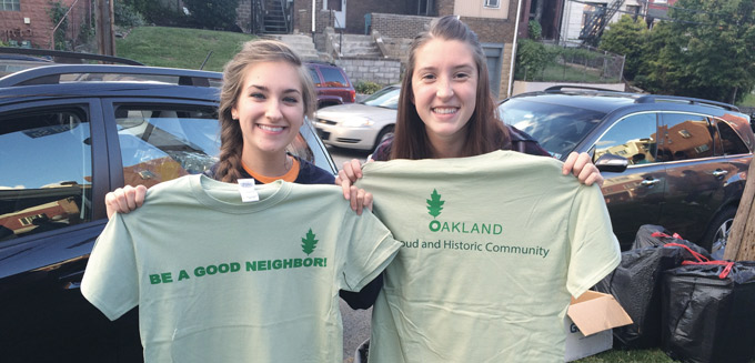 Be a Good Neighbor-girls holding t.shirts