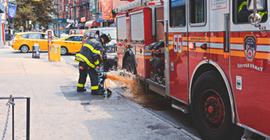 Firefighter next to truck